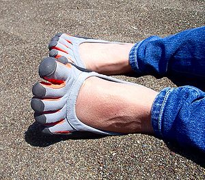 "A woman wears Vibram ""Five Fingers"" ..."