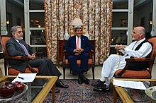 President Ahmadzai sitting with Abdullah Abdullah and John Kerry in July 2014