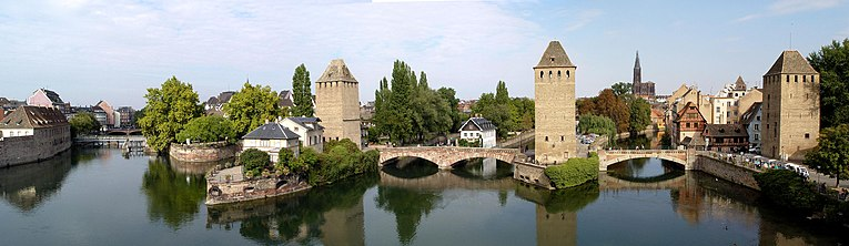Panorama from the Barrage Vauban with the medieval bridge Ponts Couverts in the foreground (the fourth tower being hidden by trees at the left) and the cathedral in the distance.
