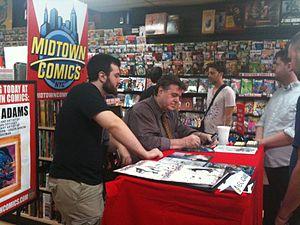 English: Comic book creators Neal Adams (seate...