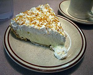 Photo of a slice of coconut cream pie. Taken a...