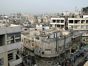 English: View of the city of Hama in Syria Fra...