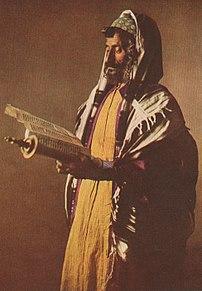 A Yemenite Jew at morning prayers, wearing a k...