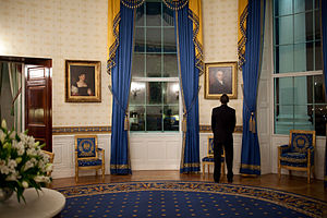 President Barack Obama looks at a portrait of ...