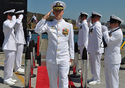 US Navy 100715-N-4047W-004 Cmdr. David Lott salutes the side boys at the conclusion of a change of command ceremony for the Los Angeles-class fast attack submarine