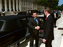 Abdullah shaking hands with former US defense secretary William Cohen outside a limousine