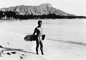 Native Hawaiian surfer with alaia board on Wai...