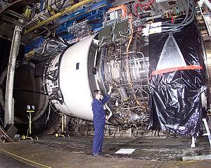Mechanic working on a Rolls Royce Trent 900 en...