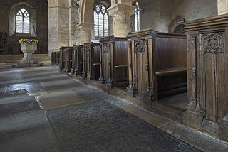 18th. cent. tombs in the nave floor and 15th. cent. bench-ends.