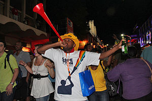 Man blowing a vuvuzela, Cape Town, South Africa