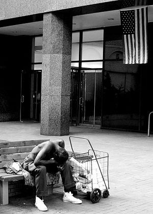 English: A homeless man in New York with the A...
