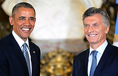 Macri and Barack Obama, smiling and shaking hands