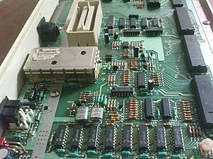 The main circuit board of an Atari 800XL computer.