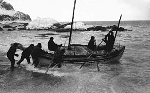 Launch of the James Caird from the shore of El...