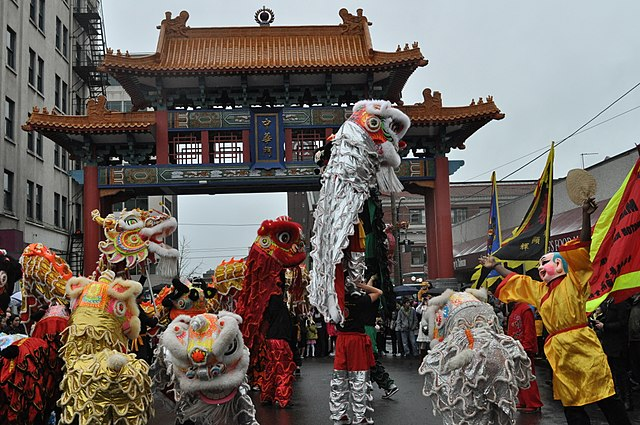 Lion dancers at Historic Chinatown Gate, Chinese New Year, Hing Hay Park, Seattle, Washington
