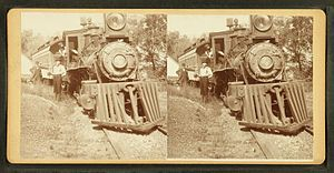 Locomotive and tender with engineer and other ...