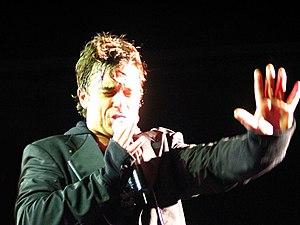 Robbie Williams singing in concert