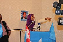 Somali activist Shadya Yasin energizes the crowd at a pro-Farmajo rally in Toronto (June 2011).
