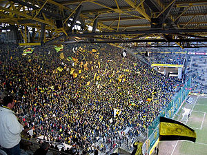 Fans of Borussia Dortmund support their team e...