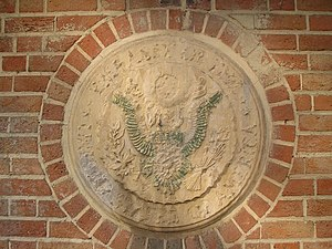 A defaced Great Seal of the United States at t...