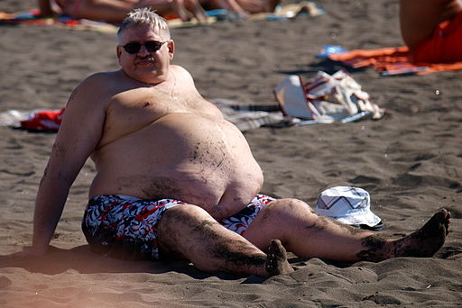 At the beach - male abdominal obesity