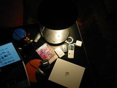 Gadgets on a table with lamp 12-2004
