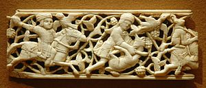 Panel with hunters. Carved and engraved ivory ...