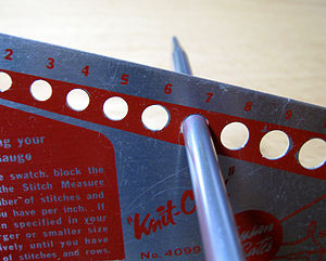 English: A size checker for knitting needles, ...