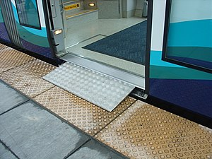 The wheelchair ramp, or bridge plate in the do...