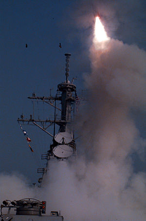 One of eight Tomahawk cruise missiles launches...