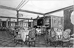 View of an ornate wood-panelled restaurant. Tables with four or five cushioned chairs are visible around the scene, with rolled napkins and table lamps set out on the table tops.