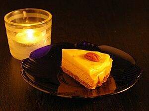 Vegan pumpkin pie with tealight.