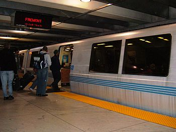 Passengers board a Fremont-bound BART train at...