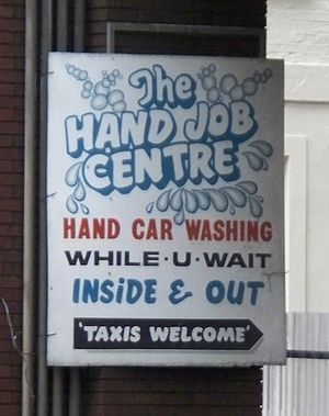 "Sign for ""London Handjob Centre"" car..."