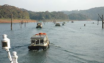 tourists in boats in the Periyar National Park...