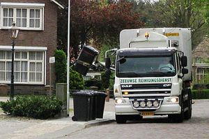 Garbage truck collecting garbage in Aardenburg.