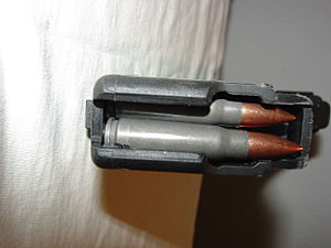English: 30 round AK-47 magazine loaded. One b...