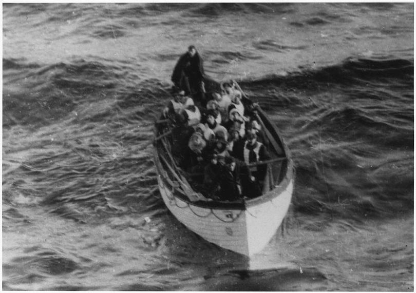 A lifeboat filled with people after the Titanic sank.