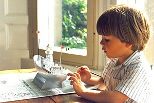 4-year-old boy painting Revell model