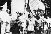 Indonesian flag raised 17 August 1945.jpg