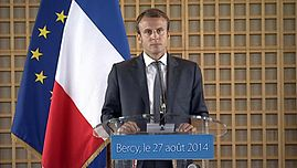 Macron as the French Minister for the Economy and Finance.