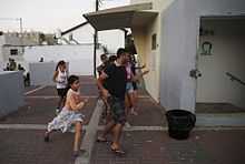 Israelis in Ashkelon run for shelter following a missile alert during Operation Protective Edge
