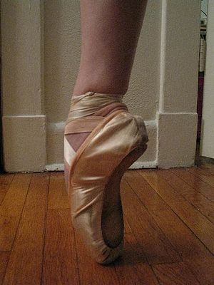 One foot shown en pointe.