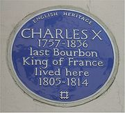 Shows plaque outside house where Charles X lived in london