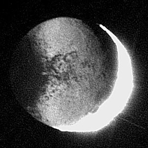Saturn's moon Iapetus lit by Saturnshine. This...