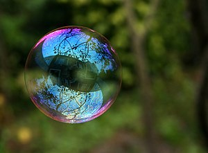 Reflection in a soap bubble.