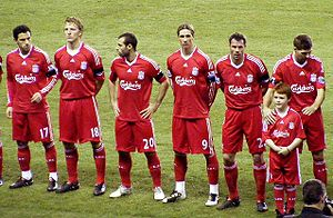 Liverpool F.C. players line up before match ag...