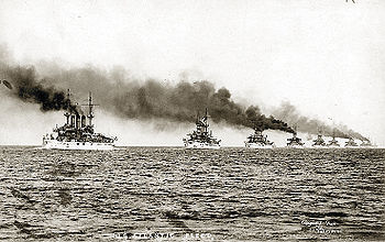 USS Kansas sails ahead of the USS Vermont as the fleet leaves Hampton Roads, Virginia on December 16, 1907.