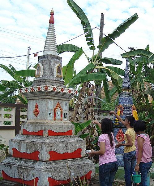 Buddhist takes a bath ancestor pagoda in Songkran festival Uttaradit, Thailand, 2007.  By Tevaprapas Makklay