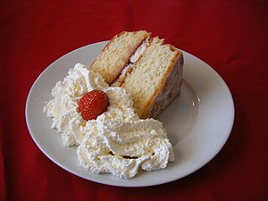 Victoria Sponge cake with cream and a strawber...